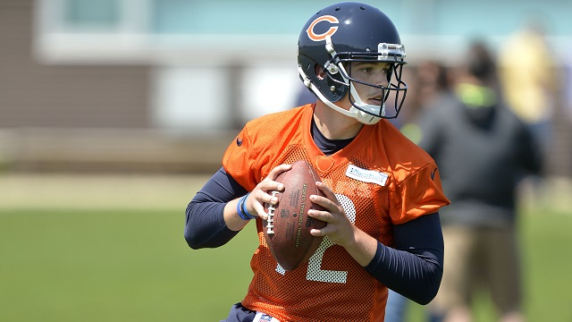 LAKE FOREST, IL - MAY 18:  Quarterback David Fales #12 of the Chicago Bears works out during rookie minicamp at Halas Hall on May 18, 2014 in Lake Forest, Illinois.   (Photo by Brian Kersey/Getty Images)